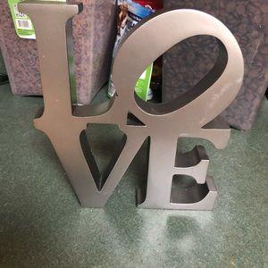 Silver love figurine